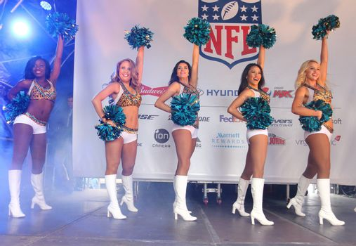 UNITED KINGDOM, London: Cheerleaders perform for thousands of fans at the American football festivities on October 24, 2015 before the regular-season NFL game between the Bills and the Jaguars is played at Wembley Stadium.  The NFL has been holding regular-season games in London since 2007, typically including an 'NFL on Regent Street' event the day before the game.