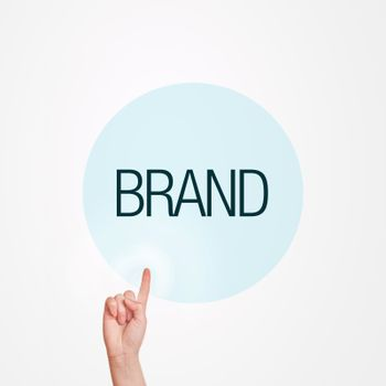 Caucasian female hand pushing Brand button. Concept of brand awareness.