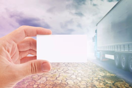 Hand holding blank Business Card for Truck Transportation Company, Copy Space Template for text or design.
