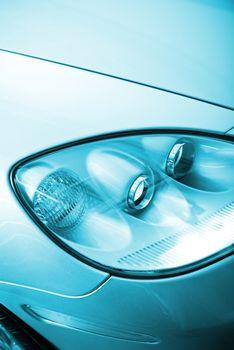 Car Design Concept. Modern Headlight Optics Closeup. Transportation Theme.