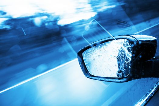 Driving Concept - Blue Color Grading. Modern Car Side Mirror.