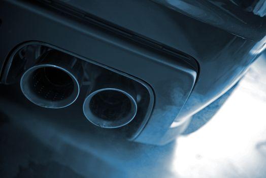 Smoking Exhaust Closeup. Modern Car Exhaust. Ecology in Transportation Concept.