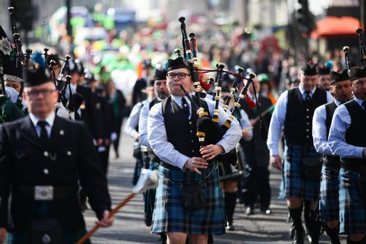 UNITED KINGDOM, London: Bagpipe players are pictured during St Patrick's Day parade near Trafalgar Square in London on March 13, 2016.