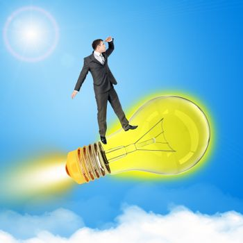 Man travel on bulb in sky with clouds