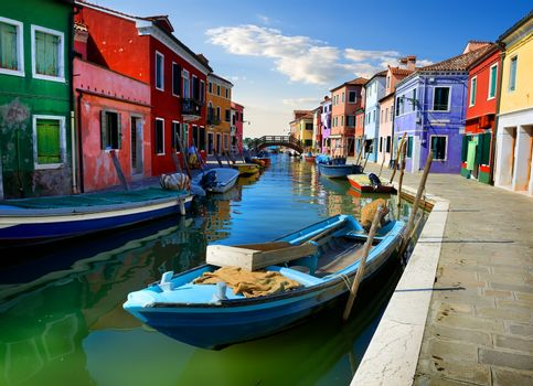 Boats and colored houses in summer Burano, Italy