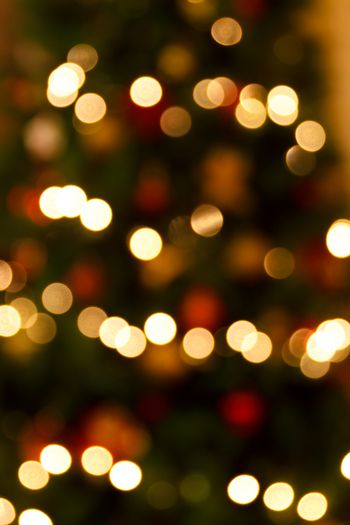 abstract christmas background with defocused lights, red and gold