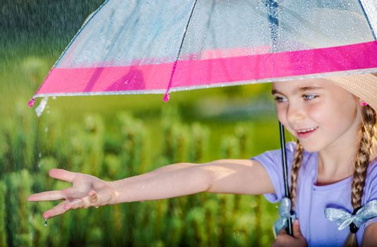 The Summer Rain. Caucasian Girl Under Transparent Umbrella.