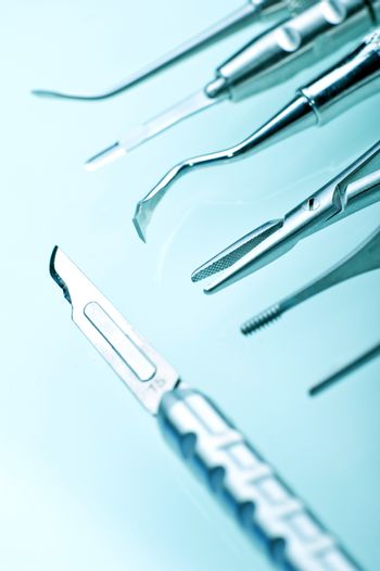 Dentist Equipment Included Small Scalpel. Dental Equipment Vertical Photography.