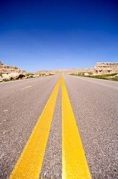 Highway to West. American Highway Thru Badlands. Transportation Photo Collection