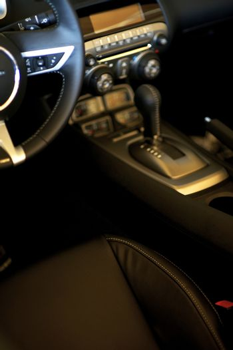 Sporty Car Interior. Dark Leather Interior. Transportation Photo Collection.