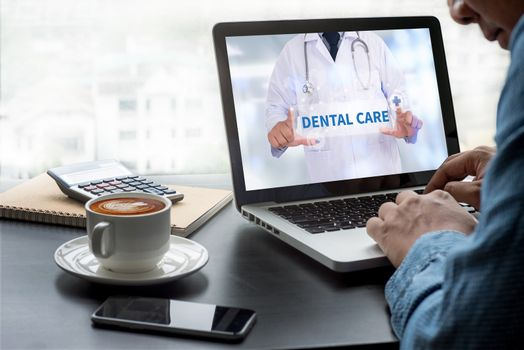 DENTAL CARE Thoughtful male person looking to the digital tablet screen, laptop screen,Silhouette and filter sun