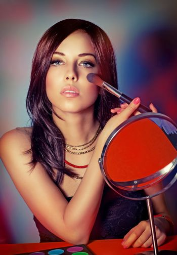 Fashion woman portrait, attractive model doing beautiful makeup, preparation to party, gorgeous stylish look for luxury photo shoot