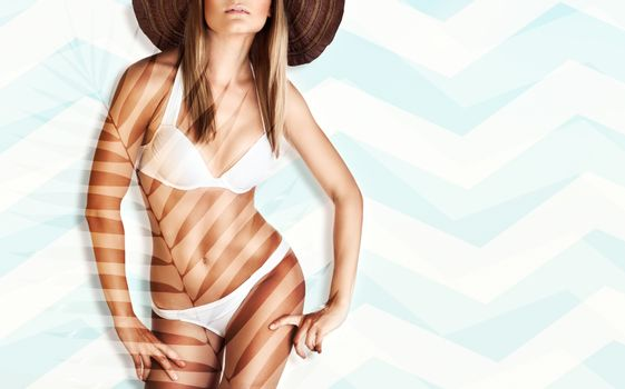 Beautiful model with a perfect body posing, body part, photo with copy space, fashion beach style, luxury summer vacation