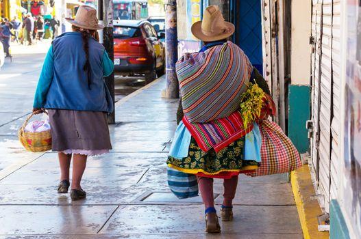 Peruvian people in city street