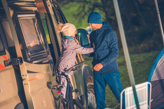 Vacation Camper Van Travel. Father with Daughter Having Fun on the Campground RV Park.