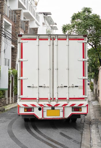 Details of White truck for delivery of goods and products. Transportation and Logistics