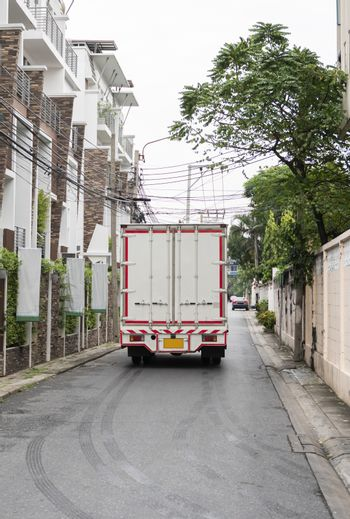White truck for delivery of goods and products. Transportation and Logistics