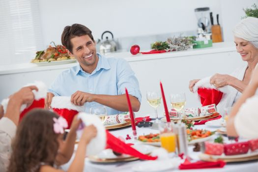 Cheerful family dining together for christmas