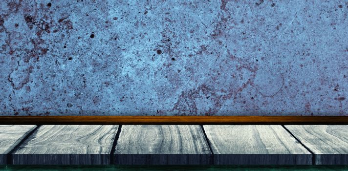 Wooden table against a texture wall