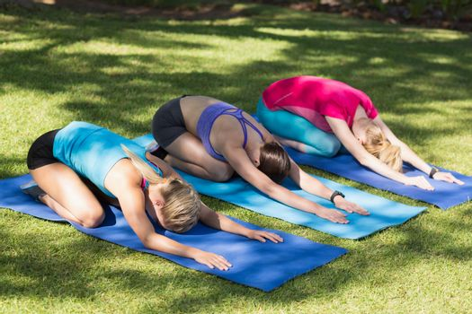 Young women doing yoga