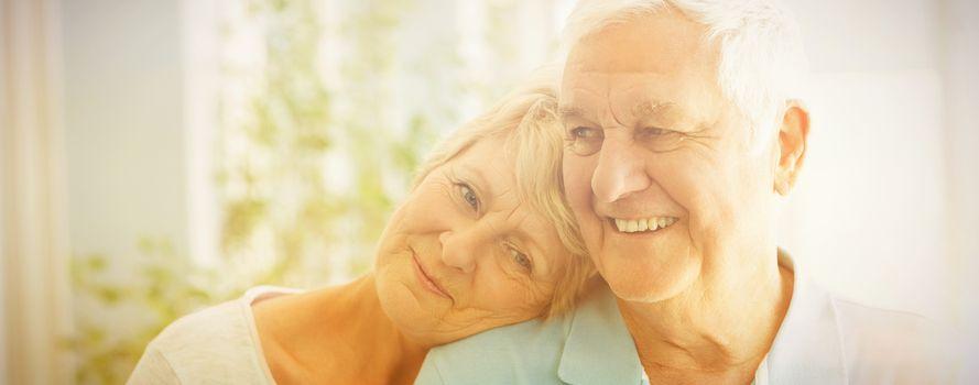 Happy romantic senior couple smiling at home