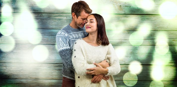 Romantic couple in warm clothing against background full of blurred light
