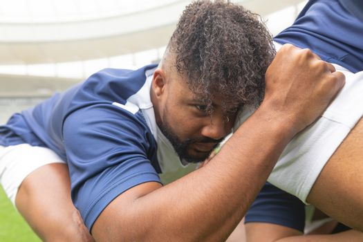 Side view of young African American male rugby players ready to play rugby match in stadium