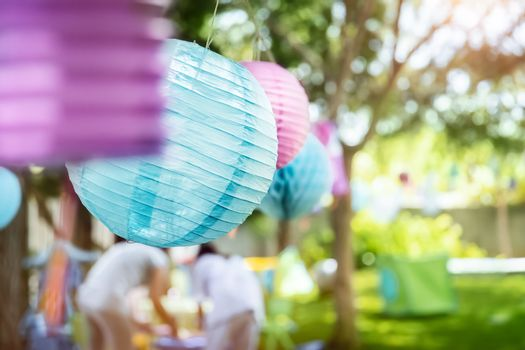 Decorations for outside event, colorful paper balloons, happy children's birthday party in sunny day on backyard, happy life