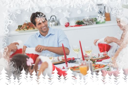 Cheerful family dining together against fir tree forest and snowflakes