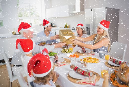 Composite image of Festive family exchanging gifts against snow falling