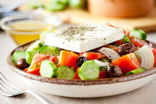 Bowl of homemade greek salad with organic vegetables and feta cheese