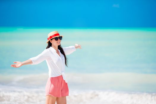 Young fashion woman in hat on the beach