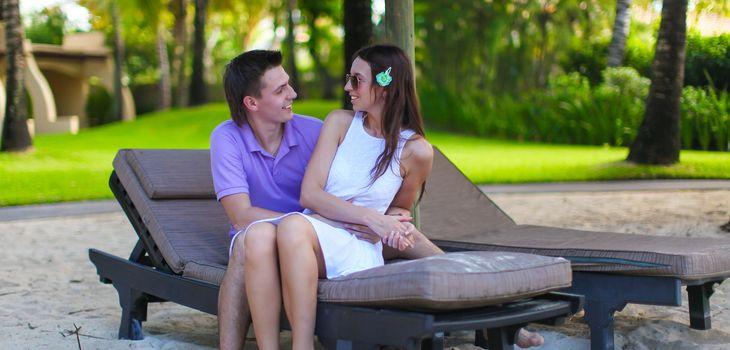 Romantic couple enjoying vacation on tropical white beach