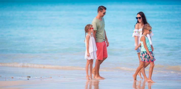 Family of four on the beach