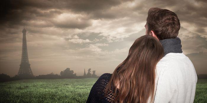 Close up rear view of romantic couple against paris under cloudy sky