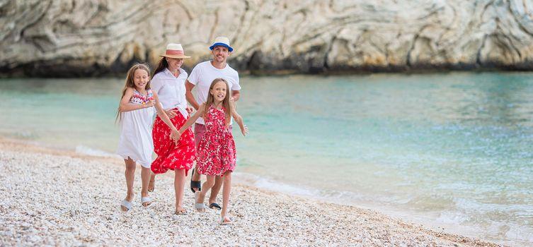 Family on the beach having fun