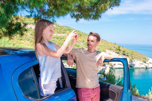 Family of father and little daughter travel by car