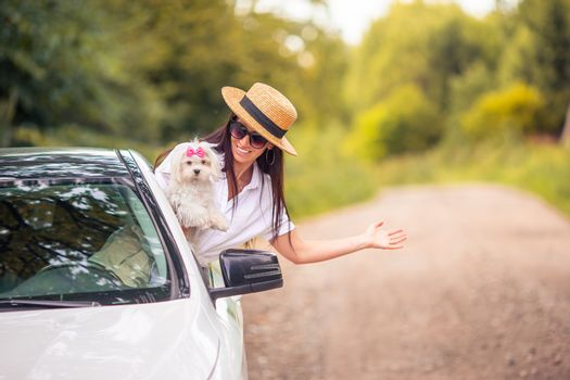 Girl tourist in the car travel on summer vacation