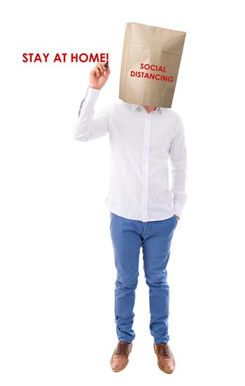 Social distancing to avoid the spread of coronavirus. Man covered head with paper bag.