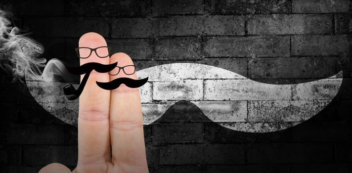 Fingers with mustache against texture of bricks wall