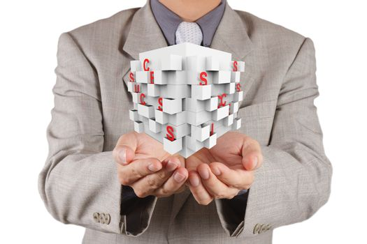 businessman hand shows cube of success as concept