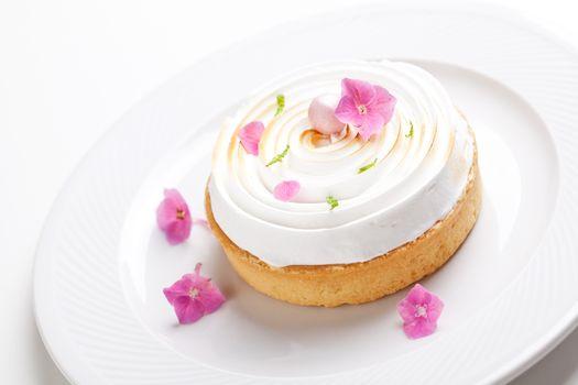 Gourmet lemon pie with  meringue and edible flowers