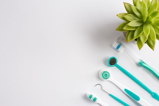 Teeth dental care instruments on white background