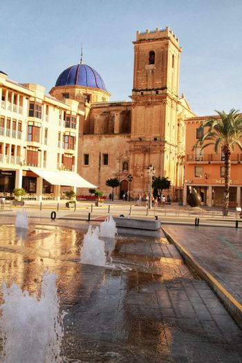 Elche, Alicante, Spain- September 12, 2020: People walking through Eucharistic Convent Square in Elche, Alicante in a sunny day of summer