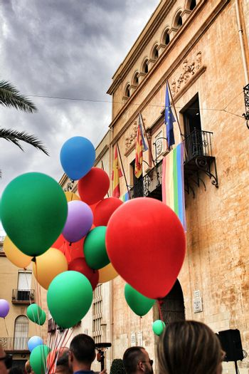 Colorful balloons decorating the town hall for the Gay Pride Day in Elche