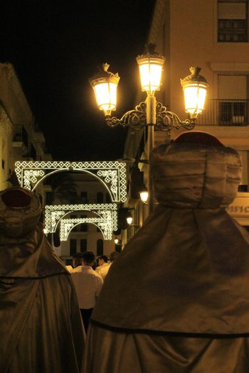 Elche, Alicante, Spain- August 10, 2019: People walking and showing traditional costumes in the Parade of Moors and Christians for the festivities of Elche, Alicante, Spain in summer