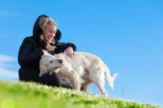 Woman and dogs portrait playing in the park.Companion pets concept