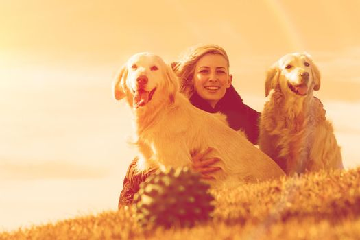 Woman and dogs portrait portrait playing in the park.Companion pets concept