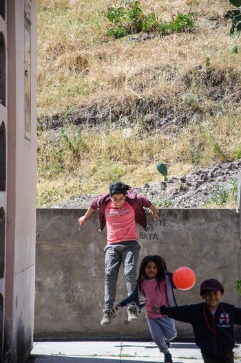 Lima, Peru - JULY 27th 2018 : Patriotic festivities in city of Canta. Children playing in the cemetery of the city of Canta