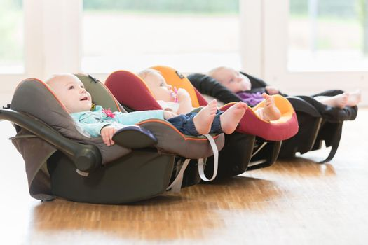 New-born infants in toddler group lying in baby shells